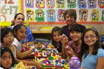Children Building with Legos Together at Mini Center