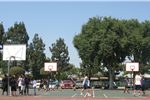 People Playing on the Tennis/Basketball Courts at New Temple Park